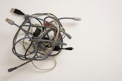 Tangled ball of cords. Ball of tangled cords on a white isolated background royalty free stock photography