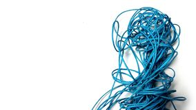 Tangled blue thread on white background royalty free stock image