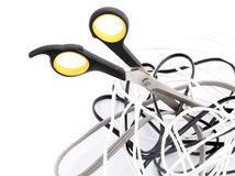 Tangled cables and scissors Royalty Free Stock Images