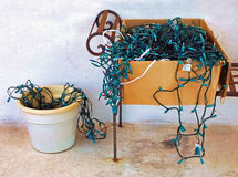 Tangled Christmas Lights. Tangled disorganized Christmas lights spilling out of a cardboard box Stock Photo