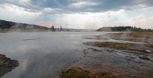 Tangled Creek emptying into Hot Lake hot spring in the Lower Geyser Basin in Yellowstone National Park in Wyoming USA Stock Images
