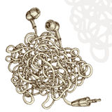 Tangled earphones Royalty Free Stock Images