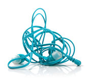 Tangled earphones isolated on white Stock Images
