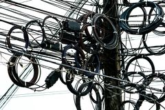 Tangled electrical wires on urban electric pole. Disorganized and messy to organization management concep. T stock images