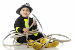 Tangled in the Fire Hose Stock Photos