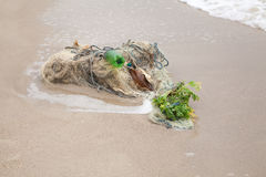 Tangled fishing nets on the beach Royalty Free Stock Photo