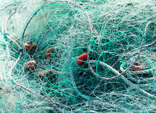 Tangled green fishing nets Royalty Free Stock Photo