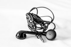 Tangled headphones on white stock photos