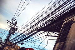 Tangled and messy electrical cables in Bangkok city, Thailand Royalty Free Stock Image