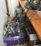Tangled messy electrical cords Royalty Free Stock Photos