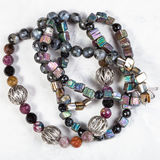 Tangled necklace from rainbow pyrite stones. Tangled necklace from rainbow pyrite natural crystals, tourmaline and agate balls, silver and nacre beads on Royalty Free Stock Images