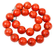 Tangled necklace from red coral beads Royalty Free Stock Images