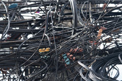 Tangled power cables Stock Photo