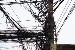A tangled power line and cord Royalty Free Stock Photo