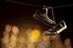 Tangled shoes. A pair of shoes tangled on a wire Royalty Free Stock Photo
