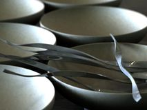 Tangled silver sticks. Attractive metal ornaments in a crackled porcelain bowl Royalty Free Stock Photography