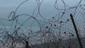 Tangled strands of razor barbed wire stock video footage