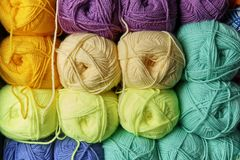 Tangles of multi-colored yarn stock images