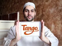 Tango application logo. Logo of Tango application on samsung tablet holded by arab muslim man. Tango is a third-party cross platform messaging application Royalty Free Stock Photos
