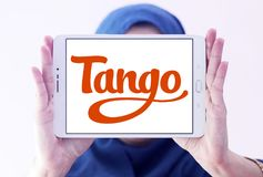 Tango application logo. Logo of Tango application on samsung tablet holded by arab muslim woman. Tango is a third-party cross platform messaging application Stock Photo