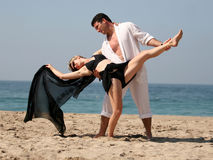 Tango on the beach. Young couple dancing on the beach Stock Images