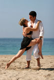 Tango on the beach. Young couple dancing on the beach Royalty Free Stock Photography
