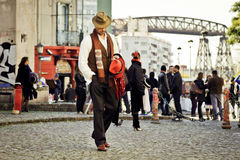 Tango in Buenos Aires. A man in a characteristic costume walks along Caminito street, an important tourist spot in Buenos Aires Stock Photography