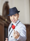 Tango Dancer Holding Rose While Performing In Restaurant. Portrait of confident male tango dancer holding rose while performing in restaurant Stock Photos