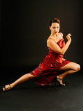 Tango dancer. Photo of a young beautiful woman performing tango moves Royalty Free Stock Image