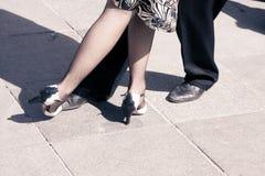 Tango dancers. Street dancers performing tango dance. Aged tone. Copy space Royalty Free Stock Photos