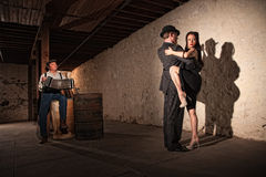 Tango Dancers With Bandonion Player Stock Photos