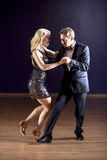Tango dancers in dance studio Stock Photography