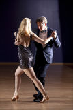 Tango dancers in dance studio Royalty Free Stock Images