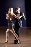 Tango dancers in dance studio Royalty Free Stock Images