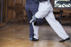 Tango Dancers Performing Gancho Step In Restaurant. Low section of male tango dancers performing gancho step in restaurant Stock Image