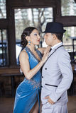 Tango Dancers Performing While Looking At Each Other In Restaura. Passionate male and female tango dancers performing while looking at each other in restaurant Royalty Free Stock Image