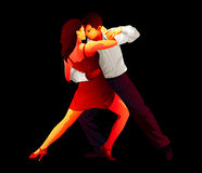 Tango lovers. Passionate young tango dancers isolated over black Royalty Free Stock Photo