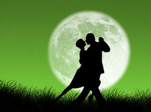 Tango in the moon. Couple dancing a tango in the moonlight