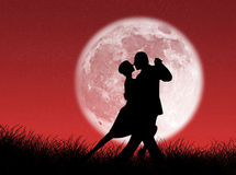 Tango in the moon. Couple dancing a tango in the moonlight Stock Image