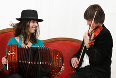 Tango musicians with bandoneon and violin Stock Photos