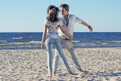 Tango op het strand Stock Foto