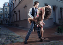 Tango on the street. Young couple perform dance steps on the street Royalty Free Stock Photos
