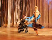 Tango in una sedia a rotelle Immagini Stock