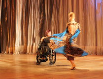 Tango in a wheelchair Stock Images