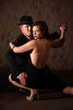 Tangodansare som rymmer hans deltagare Royaltyfri Fotografi