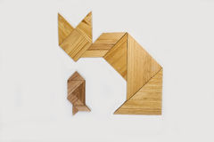 Tangram. Cat and fish characters created from wooden tangram pieces Stock Image