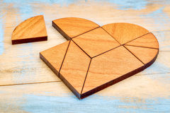 Tangram di legno del cuore Fotografia Stock
