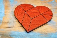 Tangram di legno rosso del cuore Fotografia Stock
