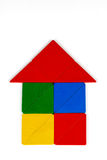 Tangram House Icon. Colorful Tangram House icon made square and triangle wood pieces of tangram Stock Photos