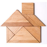 Tangram Puzzle Figure: House. House built from pieces of a traditional Japanese and Chinese Puzzle Game made of different wood parts Royalty Free Stock Images